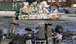 ** FILE ** In a photo from Tuesday, Dec. 10, 2013, an art installation is seen at the Heidelberg Project in Detroit. There have been at least eight fires since early May leading to questions about who might be targeting the installation and why they want to burn it down. (AP Photo/Carlos Osorio)