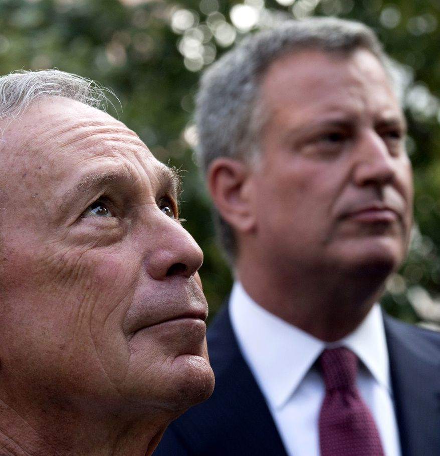 FILE. In this Sept. 11, 2013 file photo, New York Mayor Michael Bloomberg, left, and  Bill de Blasio, who was later elected to succeed Bloomberg, attend a 9/11 Memorial ceremony marking the 12th anniversary of the 2001 terrorist attacks on the World Trade Center in New York. When Michael Bloomberg became New York City's mayor 12 years ago, he was a political neophyte faced with the aftermath of the Sept. 11 terror attacks. Now, as he prepares to leave office at month's end, he has dramatically reshaped the city.(AP Photo/Adrees Latif, Pool, File)