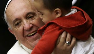 """Pope Francis  holds a baby as he meets children at the Vatican, Saturday, Dec. 14, 2013. Pope Francis has received a candle-topped birthday cake three days early, a surprise from children at the Vatican. The pontiff turns 77 on Dec. 17. A group of children on Saturday presented him with the treat after he visited a Vatican dispensary which provides pediatric care. Francis blew out the candles. Thanking the youngsters for the cake, he promised: """"I'll tell you later if it's good or not."""" The dispensary on the Vatican grounds has been distributing for more than 90 years milk, clothing, diapers, toys and even baby carriages to families in need. The dispensary on the Vatican grounds has been distributing for more than 90 years milk, clothing, diapers, toys and even baby carriages to families in need. (AP Photo/Gregorio Borgia)"""