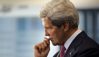 Secretary of State John F. Kerry listens during a presentation at a business event in Ho Chi Minh City, formerly Saigon, on Saturday, Dec. 14, 2013. (AP Photo/Brian Snyder, Pool)