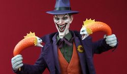 Sideshow Collectibles' sixth scale Joker shows off his mutated fish. (Photo by Joseph Szadkowski/The Washington Times)