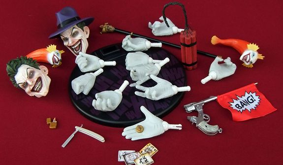 Sideshow Collectibles' sixth scale Joker comes with a variety of accessories including two head sculpts and ten hands. (Photo by Joseph Szadkowski/The Washington Times)
