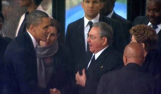 Barack Obama shakes hands with Raul Castro at the memorial service for Nelson Mandela                   Associated Press photo