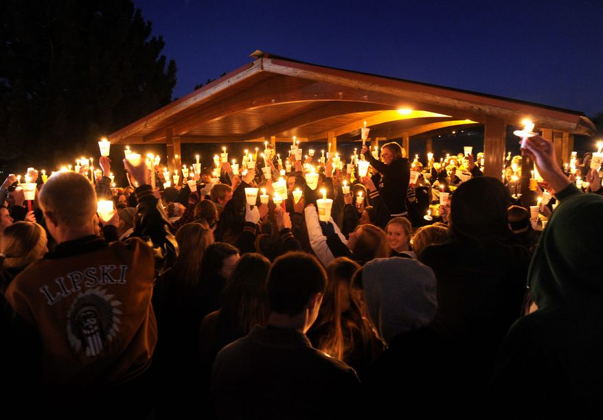 Hundreds of Arapahoe High School students gathered for a candlelight vigil Saturday night at Arapahoe Park in Centennial, Colo., to share their prayers for classmate Claire Davis. She was shot at the school Friday by 18-year-old Karl Pierson, who then shot himself. The wounded student remained in critical condition Sunday. (associated press)
