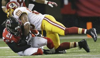 Atlanta Falcons cornerback Desmond Trufant (21) comes up with an interception as Washington Redskins wide receiver Pierre Garcon (88) defends during the second half of an NFL football game, Sunday, Dec. 15, 2013, in Atlanta. (AP Photo/John Bazemore)