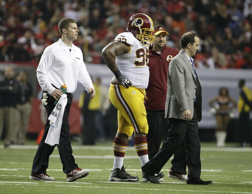 Washington Redskins defensive end Chris Baker (92) walks off the field after an injury against the Atlanta Falcons during the second half of an NFL football game, Sunday, Dec. 15, 2013, in Atlanta. (AP Photo/David Goldman)