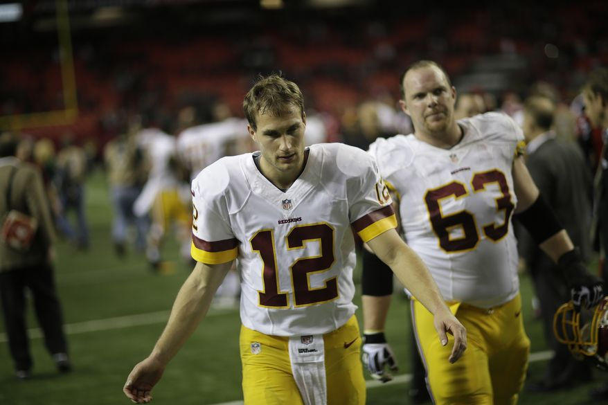 Washington Redskins quarterback Kirk Cousins (12) walks off he field after the second half of an NFL football game against the Atlanta Falcons, Sunday, Dec. 15, 2013, in Atlanta. The Atlanta Falcons won 27-26. (AP Photo/David Goldman)