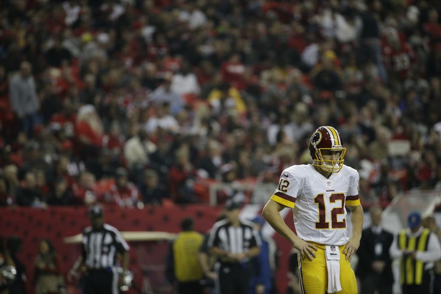 Washington Redskins quarterback Kirk Cousins (12) walks off the field during the second half of an NFL football game against the Atlanta Falcons, Sunday, Dec. 15, 2013, in Atlanta. (AP Photo/David Goldman)