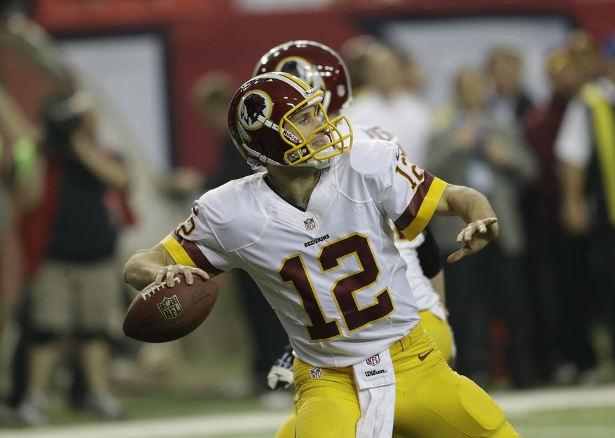 Washington Redskins quarterback Kirk Cousins (12) works against the Atlanta Falcons during the first half of an NFL football game, Sunday, Dec. 15, 2013, in Atlanta. (AP Photo/John Bazemore)