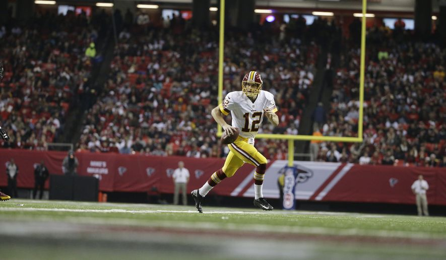 Washington Redskins quarterback Kirk Cousins (12) works against the Atlanta Falcons during the first half of an NFL football game, Sunday, Dec. 15, 2013, in Atlanta. (AP Photo/David Goldman)