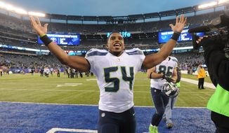 Seattle Seahawks middle linebacker Bobby Wagner (54) gestures while leaving the field after an NFL football game against the New York Giants, Sunday, Dec. 15, 2013, in East Rutherford, N.J. The Seahawks won 23-0. (AP Photo/Bill Kostroun)