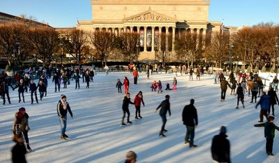 Skaters enjoy a slightly warmer afternoon at the National Gallery of Art's Sculpture Garden Ice Rink on the National Mall in Washington on Sunday, Dec. 15, 2013. (Andrew Harnik/The Washington Times)