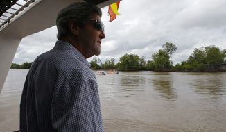 Secretary of State John F. Kerry boats through Vietnam's Mekong Delta on Sunday, Dec. 15, 2013. (AP Photo/Brian Snyder, Pool)