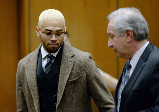 R&B singer Chris Brown, left, appears in court with his attorney Mark Geragos during a probation violation hearing in which his probation was revoked by a Los Angeles Superior judge, Monday, Dec. 16, 2013, in Los Angeles. Superior Court Judge James R. Brandlin revoked Brown's probation after his recent arrest on suspicion of misdemeanor assault in Washington, D.C., but the ruling will not alter the singer's requirements to complete reh