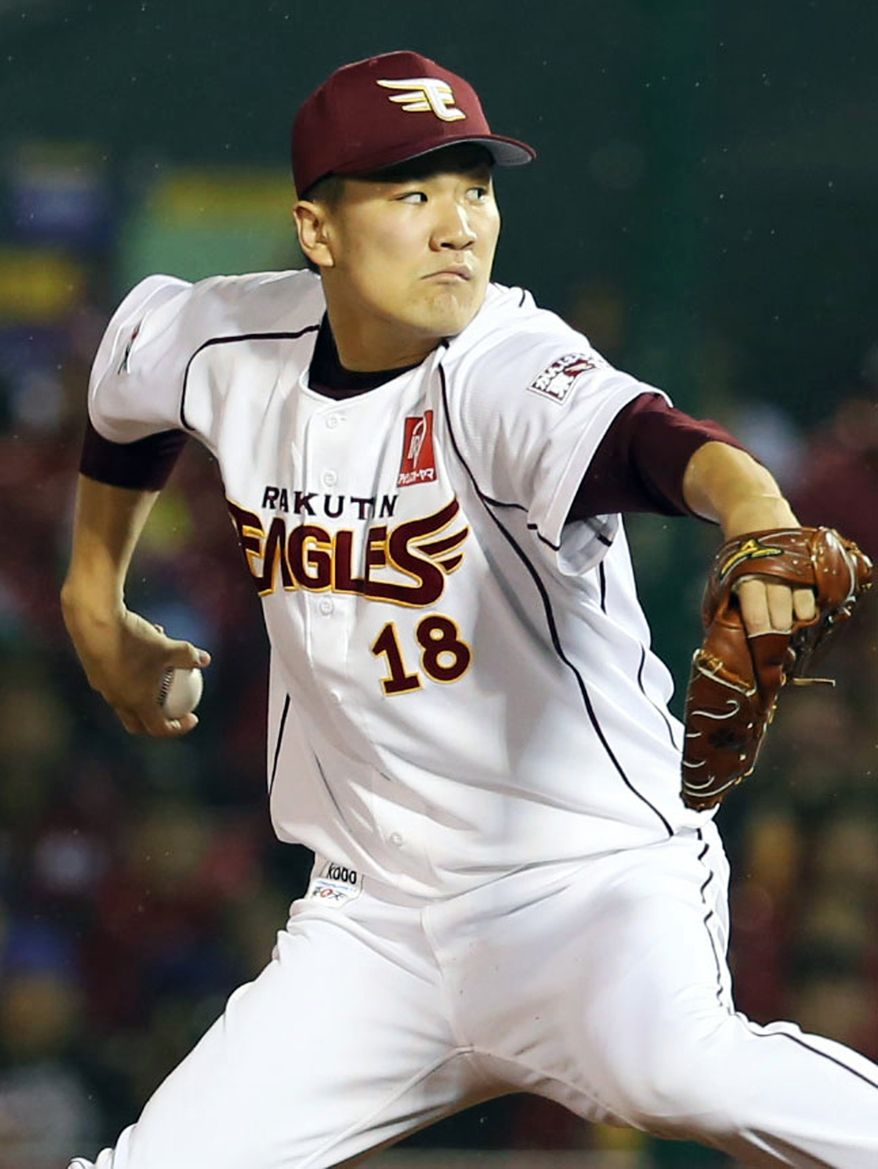 FILE - In this Nov. 3, 2013, file photo, Rakuten Eagles pitcher Masahiro Tanaka pitches against the Yomiuri Giants during Game 7 of baseball's Japan Series in Sendai, northeastern Japan. Major League Baseball and Nippon Professional Baseball have finalized a new posting system that caps the fee for players at $20 million, announced Monday, Dec. 16, a deal that may lead to star pitcher Tanaka going on the market. (AP Photo/Kyodo News, File) JAPAN OUT, CREDIT MANDATORY