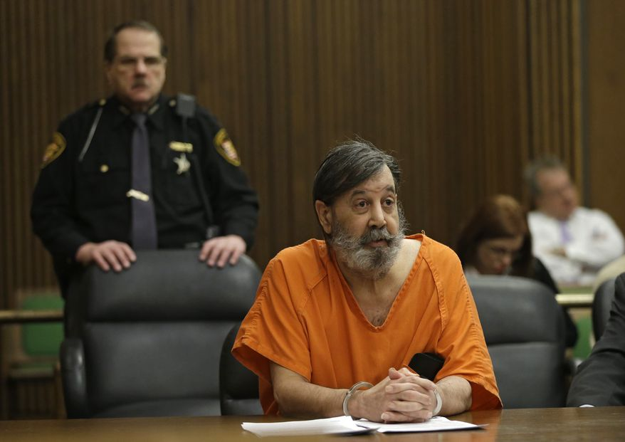 John Donald Cody, who identifies himself as Bobby Thompson, speaks during his sentencing hearing on racketeering, theft and money-laundering charges on Monday, Dec. 16, 2013, in Cleveland. (AP Photo/Mark Duncan)