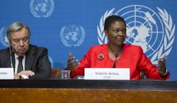 Valerie Amos, right, United Nations Under-Secretary-General for Humanitarian Affairs and Emergency Relief Coordinator, sitting next to United Nations High Commissioner for Refugees, UNHCR, Portuguese Antonio Manuel de Oliveira Guterres, left, informs to media about the humanitarian strategies and requirements 2014 including Syria and the region, during a press conference at the European headquarters of the United Nations, in Geneva, Switzerland, Monday, Dec.  16, 2013. (AP Photo/Keystone,Salvatore Di Nolfi)