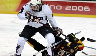 FILE - In this Feb. 12, 2006, file photo, the United States' Caitlin Cahow (8) upends Germany's Sara Seiler during the first period of a 2006 Winter Olympics ice hockey match in Turin, Italy. Cahow will join Deputy Secretary of State Bill Burns at the closing ceremony delegation of the Winter Olympics next year in Sochi, Russia. (AP Photo/Gene J. Puskar, File)