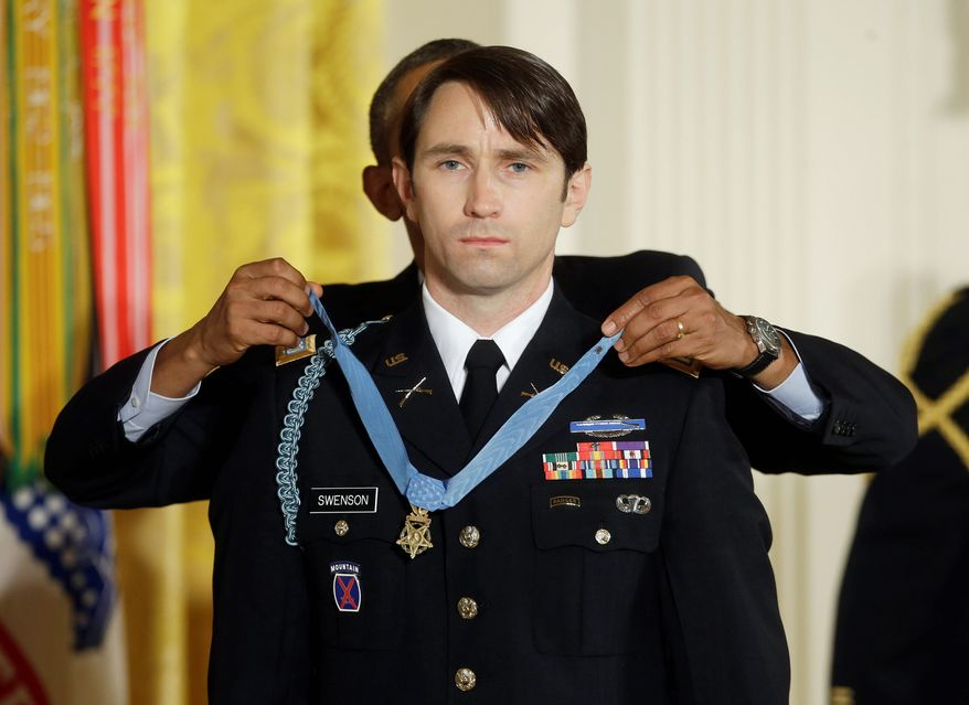 Long-Awaited Award: Former Army Capt. William Swenson received the nation's highest military honor during a White House ceremony Oct. 15 after a lengthy battle in Afghanistan in 2009 and an even longer fight with Pentagon red tape. (Associated Press photographs)
