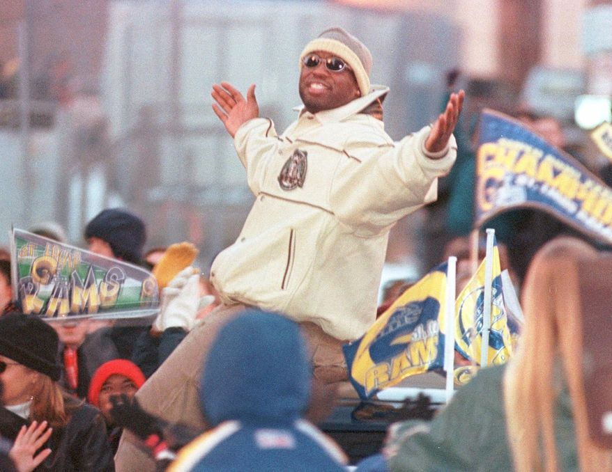 St. Louis Rams London Fletcher basks in the glory of thousands of fans as they cheer the Super Bowl Champions during their parade Monday evening, Jan. 31, 2000, in downtown St. Louis. (AP Photo/Leon Algee)