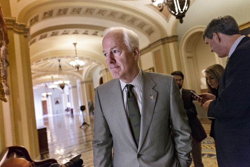 Senate Minority Whip John Cornyn, R-Texas, and other Republicans walk to a closed-door GOP meeting before the Senate moves to pass a modest, bipartisan budget bill, at the Capitol in Washington, Wednesday, Dec. 18, 2013. The bill is designed to keep Congress from lurching from fiscal crisis to fiscal crisis and ease the harshest effects of the automatic budget cuts known as the sequester. (AP Photo/J. Scott Applewhite)