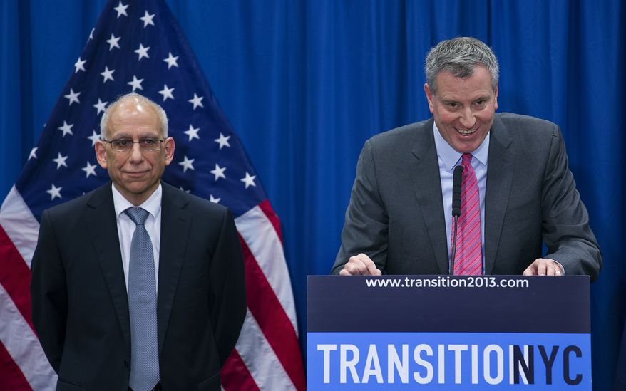 Mayor-elect Bill de Blasio, right, shares a light moment during a news conference after he announced Dean Fuleihan, left, the new Budget Director under the incoming de Blasio administration at a news conference in New York Wednesday, Dec. 18, 2013. (AP Photo/Craig Ruttle)