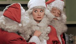 """** FILE ** This image released by CBS shows Lucille Ball, center, dressed as Santa Claus in a colorized """"I Love Lucy Christmas Special,"""" which aired on Friday, Dec. 20, on CBS. (AP Photo/CBS)"""