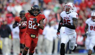 Maryland wide receiver Marcus Leak (82) runs with the ball against North Carolina State safety Dontae Johnson (25) during the first half of an NCAA football game, Saturday, Oct. 20, 2012, in College Park, Md. (AP Photo/Nick Wass)