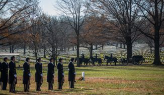 Horses carry an empty casket in front of rows of tombstones at Arlington National Cemetery, in Arlington, VA., Thursday, December 19, 2013.  (Andrew S Geraci/The Washington Times)
