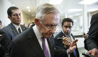 ** FILE ** Senate Majority Leader Harry Reid, is surrounded by reporters after talking about the final work of the Senate as the legislative year nears to a close, at the Capitol in Washington, Thursday, Dec. 19, 2013. (AP Photo/J. Scott Applewhite)