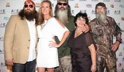 """In this May 9, 2012 photo, from left, Willie Robertson, Korie Robertson, Phil Robertson, Miss Kay Robertson and Si Robertson pose at the A&E Networks 2012 Upfront at Lincoln Center in New York. The Robertsons star in the A&E reality series """"Duck Dynasty."""" (AP Photo/Starpix, Kristina Bumphrey)"""