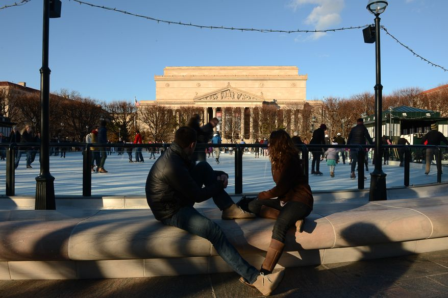 Skaters enjoy themselves on a Sunday afternoon at the Sculpture Garden Ice Rink - National Gallery of Art on the National Mall, Washington, D.C., Sunday, December 15, 2013. (Andrew Harnik/The Washington Times)