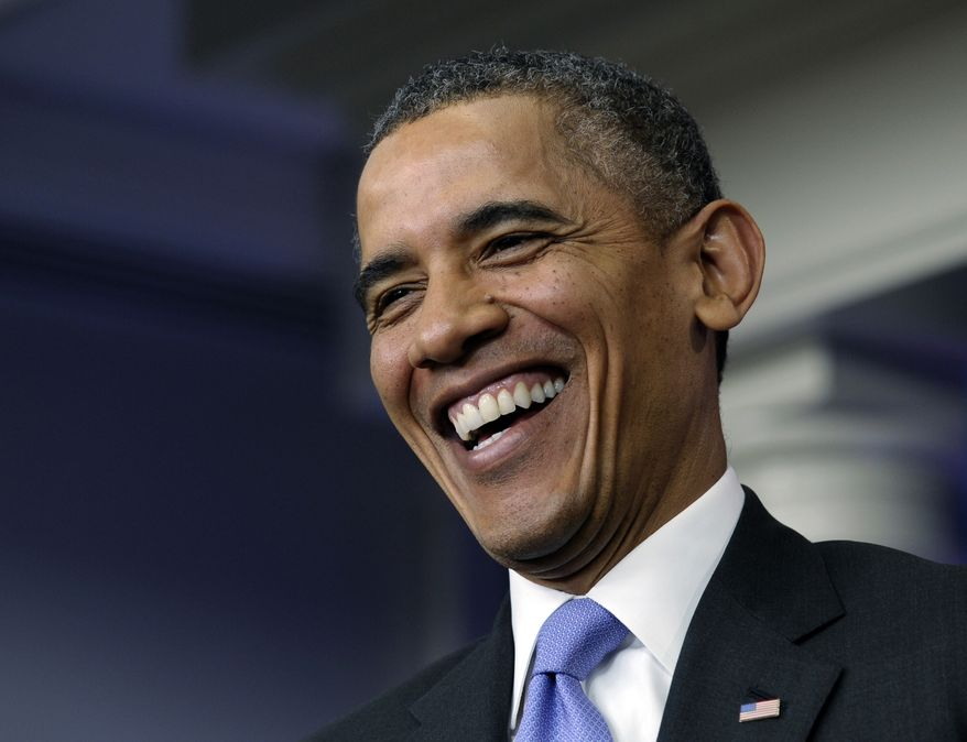 President Barack Obama laughs as he is asked a question during an end-of-the year news conference in the Brady Press Briefing Room at the White House in Washington, Friday, Dec. 20, 2013. At the end of his fifth year in office, Obama's job approval and personal favorability ratings have fallen to around the lowest point of his presidency. Obama will depart later for his home state of Hawaii for his annual Christmas vacation trip. It's the first time in his presidency that his departure plans have not been delayed by legislative action in Washington. (AP Photo/Susan Walsh)