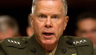 "** FILE ** Marine Corps Commandant Gen. James Amos ordered the officer overseeing a Taliban desecration case to ""crush"" the defendants shown in a video, court-martial all of them and kick them out of the Corps, according to witnesses. (Associated Press)"