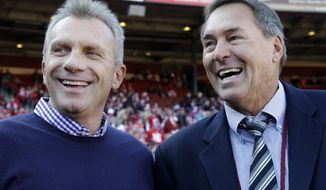 Former San Francisco 49ers quarterback Joe Montana, left, and former wide receiver Dwight Clark are shown before an NFL football game between the San Francisco 49ers and the St. Louis Rams in San Francisco, Sunday, Dec. 4, 2011. (AP Photo/Paul Sakuma)