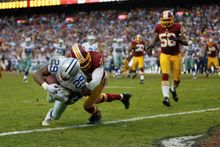 Dallas' DeMarco Murray falls into the end zone for the game-winning touchdown catch late in Sunday's game at FedExField. The come-from-behind victory sets up a winner-take-all NFC East showdown between the Cowboys and Eagles next week. (associated press)