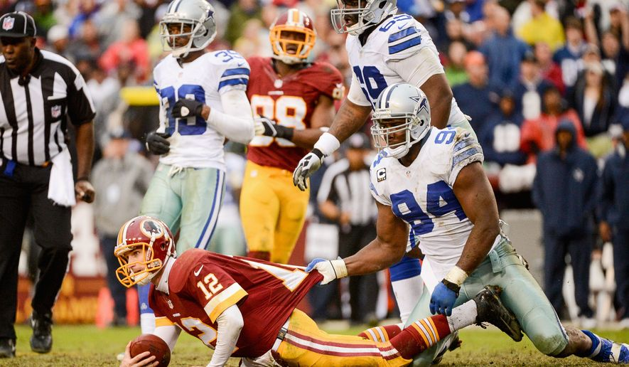 Redskins quarterback Kirk Cousins is stopped short of a first down during the fourth quarter of Sunday's loss to the Cowboys. Washington has suffered one-point losses in each of Cousins' two starts. (andrew harnik/the washington times)