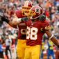 Washington Redskins tight end Logan Paulsen (82), left, celebrates with Washington Redskins wide receiver Pierre Garcon (88) after he catches an eight yard touchdown pass in the third quarter as the Washington Redskins play the Dallas Cowboys at FedExField, Landover, Md., Sunday, December 22, 2013. (Andrew Harnik/The Washington Times)