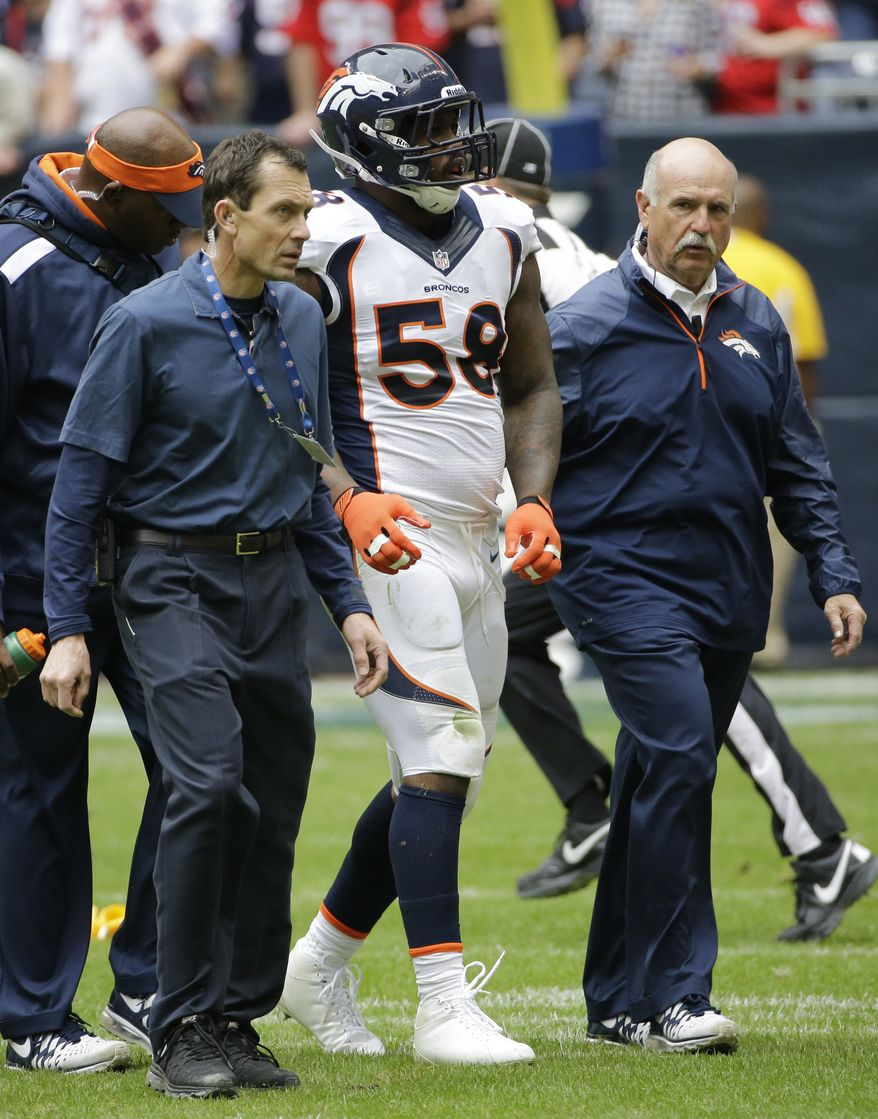 Denver Broncos' Von Miller (58) is walked off the field after he was injured during the first quarter of an NFL football game against the Houston Texans, Sunday, Dec. 22, 2013, in Houston. (AP Photo/David J. Phillip)