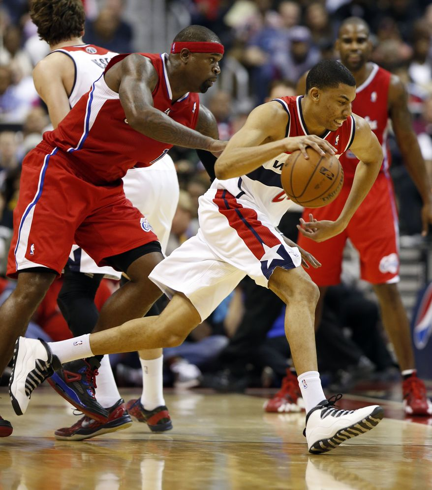 Washington Wizards forward Otto Porter Jr. (22) drives around Los Angeles Clippers forward Stephen Jackson (1) in the first half of an NBA basketball game on Saturday, Dec. 14, 2013, in Washington. The Clippers won 113-97. (AP Photo/Alex Brandon)