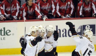 Anaheim Ducks defenseman Hampus Lindholm, left, of Sweden, celebrates his goal with Ryan Getzlaf (15), Mark Fistric, second from left, and Corey Perry (10) during the third period of an NHL hockey game against the Washington Capitals, Monday, Dec. 23, 2013, in Washington. The Ducks won 3-2. (AP Photo/Nick Wass)