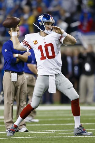 New York Giants quarterback Eli Manning (10) warms up before an NFL football game against the Detroit Lions at Ford Field in Detroit, Sunday, Dec. 22, 2013. (AP Photo/Rick Osentoski)