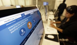 ** FILE ** In this Wednesday, Dec. 11, 2013, file photo, Rosemary Cabelo uses a computer at a public library to access the Affordable Health Care Act website, in San Antonio. (AP Photo/Eric Gay, File)