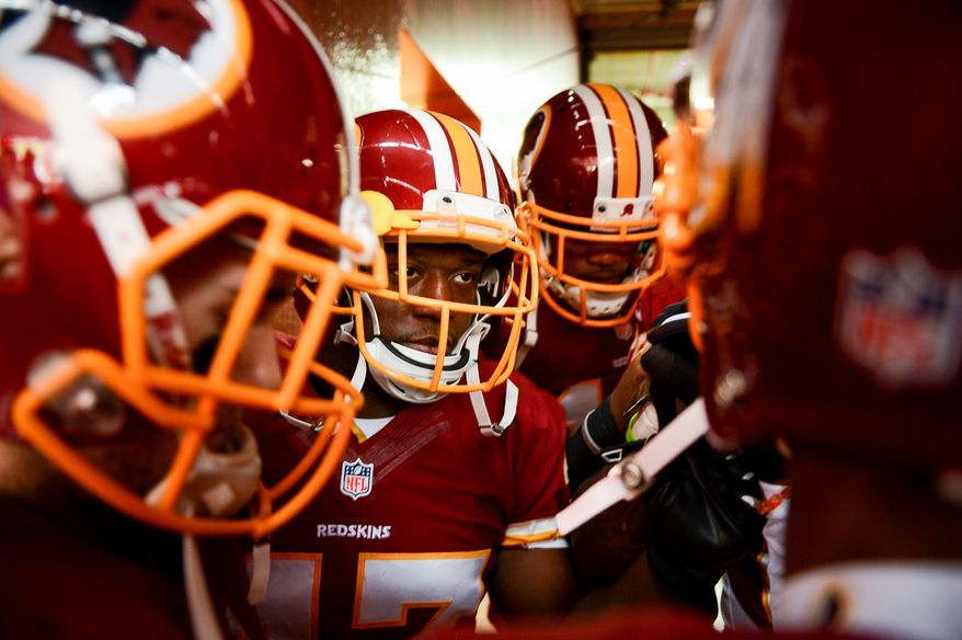 Washington Redskins running back Jawan Jamison (47), center, gets ready to take the field with his teammates as the Washington Redskins play the Dallas Cowboys at FedExField, Landover, Md., Sunday, December 22, 2013. (Andrew Harnik/The Washington Times)