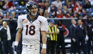 Denver Broncos quarterback Peyton Manning smiles after throwing his fourth touchdown of an NFL football game against the Houston Texans during the fourth quarter on Sunday, Dec. 22, 2013, in Houston. It was Manning's 51st touchdown pass of the season and set a new NFL record. (AP Photo/David J. Phillip)