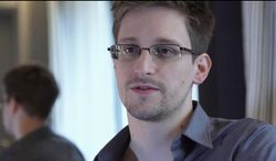"""FILE - This June 9, 2013 file photo provided by The Guardian Newspaper in London shows National Security Agency leaker Edward Snowden, in Hong Kong. Snowden says his """"mission's already accomplished"""" after leaking NSA secrets that have caused a reassessment of U.S. surveillance policies. Snowden told The Washington Post in a story published online Monday night, Dec. 23, 2013, he has """"already won"""" because journalists have been able to tell the story of the government's collection of bulk Internet and phone records. (AP Photo/The Guardian, Glenn Greenwald and Laura Poitras, File)"""