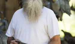 "This undated image released by A&E shows Phil Robertson from the popular series ""Duck Dynasty."" Robertson was suspended last week for disparaging comments he made to GQ magazine about gay people. (AP Photo/A&E, Zach Dilgard)"