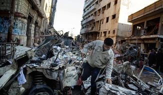"An Egyptian man makes his way through rubble at the scene of an explosion at a police headquarters building that killed at least a dozen people, wounded more than 100, and left scores buried under the rubble, in the Nile Delta city of Mansoura, 110 kilometers (70 miles) north of Cairo, Egypt, Tuesday, Dec. 24, 2013. The country's interim government accused the Muslim Brotherhood of orchestrating the attack, branding it a ""terrorist organization."" No one immediately claimed responsibility for the bombing, which came a day after an al-Qaida-inspired group called on police and army personnel to desert or face death at the hands of its fighters. (AP Photo/Ahmed Ashraf)"