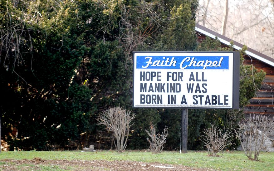 Faith Chapel in Cambria, Ill., has a simple message on its sign for the holiday season. A number of churches are now using catchy and clever messages on their signs to draw visitors. (AP Photo/The Southern Illinoisan, Adam Testa)