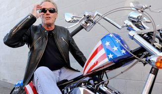 """Peter Fonda, who played Captain America in """"Easy Rider,"""" poses atop a Harley-Davidson based on the motorcycle he rode in the counterculture film released in 1969. The young Mr. Fonda and his sister, Jane (below), who also joined the family business, board a flight to Europe with their father in summer 1957. (associated press)"""